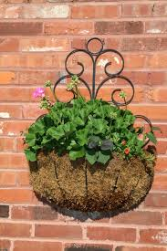 wall basket with flowers and actual sweet potatoes planter wrought iron planters attachment basket planter wicker wall