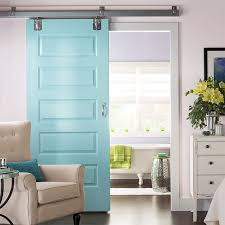 dramatic sliding doors separate. Barn-style Sliding Doors Painted A Dramatic Aqua Color Separate Bedroom And Bathroom. R