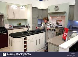 Wickes Kitchen Furniture Woman Shopping Looking At New Kitchen Kitchens At Wickes Uk Stock