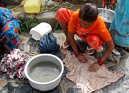 woman washing clothes by hand. Beautiful Hand Woman Washing Clothes By Hand And Woman Washing Clothes By Hand I