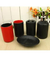 black and red bathroom accessories. red and black bathroom decor with accessories