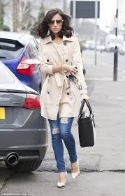 parisian chic a chic light beige oned trench coat donned her impressive figure