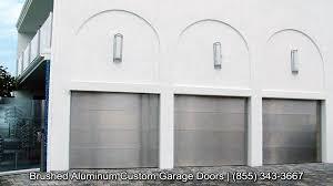 contemporary garage doors in a brushed aluminum finish get the look of stainless steel garage door today
