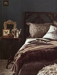 muted dark vintage style grey and brown rich textures black antique style bedroom
