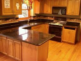 honey oak kitchen cabinets with black countertops white granite countertops with oak cabinets