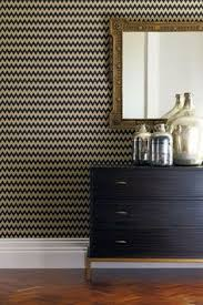 this wallpaper design would look stunningly smart in a dining room