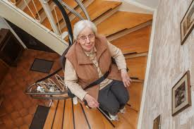 chair lift for stairs. chair lift financing woman using stair for stairs t