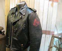 black leather motorcycle jacket vintage 1970s painted with an 8 ball chaos empire iv red spade and is a harley davidson amf