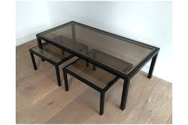 unusual black lacquered and brass coffee table with a pair of nesting or side tables underneath