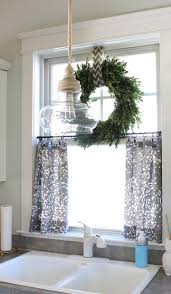 boxwood wreath on top of small curtains for kitchen window have to look into this