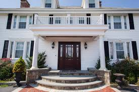 white siding and windows installed in rhode island by marshall building remodeling
