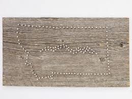 once you are done pounding nails you can lift and toss your template string art 3