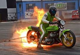 strange drag bike burnout big flames racing motorcycle with