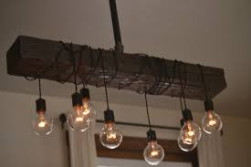 wood lighting. DESCRIPTION: Combining Both Wood And Steel, There Is No Place That This Light Cant Be Use. The Distressed Beam You See In Picture Has Lighting S
