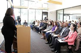 naturalization ceremony held at kingsgate library kirkland reporter immigration services officer nicole al khafaji speaks to 20 local immigrants before they become u s citizens during a naturalization ceremony at the