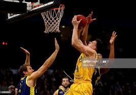 Marlon Theis of Braunschweig challenges Ivan Elliott of Hagen during...  News Photo - Getty Images