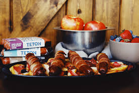 bacon wrapped sausages with apples berries grfed beef