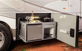 the winnebago tour s makes outdoor entertaining is easy with the available tailgate package featuring a single burner induction range top stainless steel