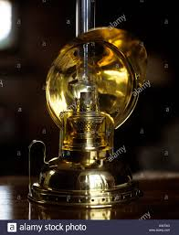 Old Brass Oil Lamp With Reflector To Magnify Light On Polished