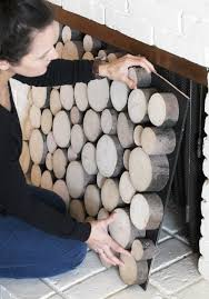 you ve probably seen the stacked logs in a fireplace trend on now is your chance to jump on that bandwagon glue slices of logs in diffe