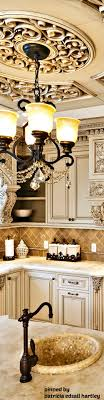 design ideas betty marketing paris themed living: opulent tuscan style kitchen cream with brown glaze cabinets offers free custom drapery designs to coordinate with this look