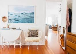 share on wall art hanging height with how to hang a picture wall art tips video apartment therapy