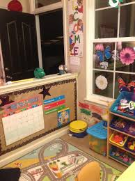 Small daycare layout: I love the calendar on the wall to do every day with  kids
