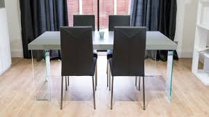 rectangular dining table with black dining chairs