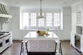 kitchen island legs amazing kitchen features an industrial pendant illuminating a square c