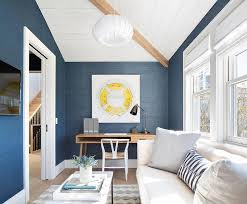 wall mounted home office. white and blue home office with sofa wall mounted