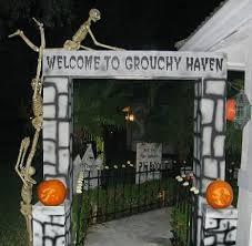 DIY Halloween Graveyard Entrance made with styrofoam, cardboard, and paint.