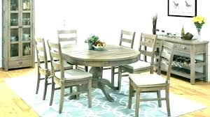 pictures of rugs under dining room tables rug under dining room table cowhide rug under dining