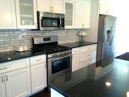 white cabinets with dark granite off kitchen home countertops