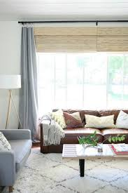 brown leather couch decor looking at ways to lighten up a living room with dark leather seating love the blue gray taupe