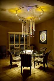 crystal ornaments catch the illumination from led and halogen lights in this chandelier designed by michael
