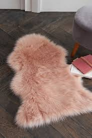 pink luxury faux sheepskin rug
