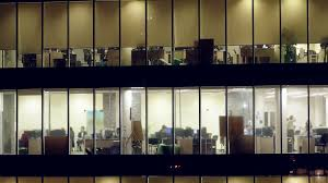 inside lighting. Modern Glass Office Building With People Working Inside. Business Center Lighting Windows Inside G