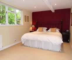 maroon and white bedroom. Modren Maroon Photo Of Beige Maroon Plum Red White Bedroom With Feature Wall  Colour  Idea Maroon Intended And White Bedroom