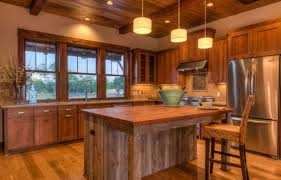 rustic kitchen with central island and single bar chair in the wooden kitchen furniture