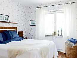 simple apartment bedroom decor. Enchanting Apartment Bedroom Decorating Idea With White Window Curtain Also Tiny Floral Wallpaper Feat Contemporary Bedding Simple Decor