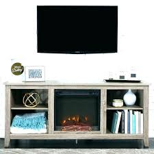 white fireplace stand next to with electric tv canadian tire fire