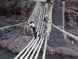 Craftsmen from the Huinchiri community depend on teamwork to craft the  bridge, the safety measures have been passed down through the generations  and involve ...