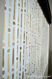 have you ever thought to stencil your vertical blinds h2obungalow loves how this simple