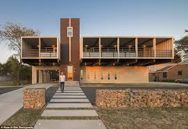 Dallas architects Matt Mooney and Michael Gooden have transformed 14 shipping  containers into a stunningly modern