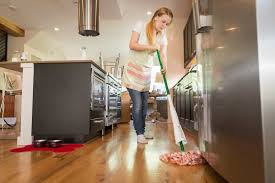 a woman mopping the floor