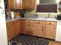 oak cabinets with glass doors dated oak cabinets once again upper kitchen cabinets with glass doors