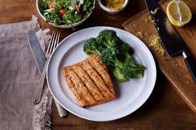 mesquite wood grilled salmon with garlic dill sauce broccoli at logan s roadhouse