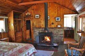 cabin with fireplace. cabin interior, bedroom, fireplace with r