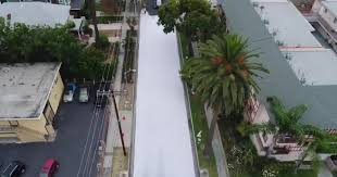 los angeles is painting some of its streets white and the reasons why are pretty cool cbs news