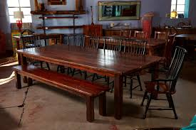 this really big table and the bench to match is built from wood pulled